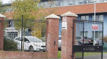 woman accused of defrauding northern ireland school of funds