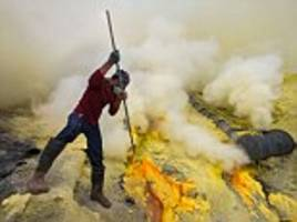 sulphur miners risk their lives to brave active volcano