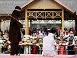 Indonesians lashed for breaking Sharia law