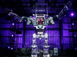 Amazon CEO Jeff Bezos piloted a 13-foot high robot (AMZN)