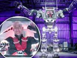 Amazon CEO Jeff Bezos pilots giant robot