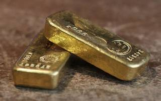 Gold prices hit a two-week high as the US dollar edges lower