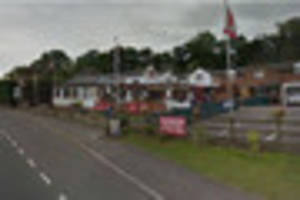 Man and woman arrested after young boy wanders into village pub...