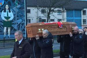 mourners pay their respects as derry city skipper ryan mcbride's coffin is carried through the streets
