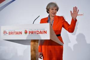 theresa may sets date for triggering article 50 and kicking off brexit process