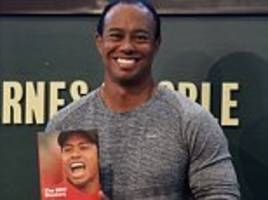 tiger woods draws a crowd as he launches book