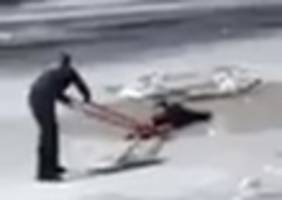 watch cops rescue yet another teen who fell through frozen central park pond