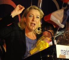France's Marine Le Pen under fire in first presidential debate