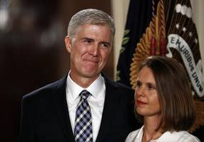 The Latest: Gorsuch refuses to opine on immigration ban