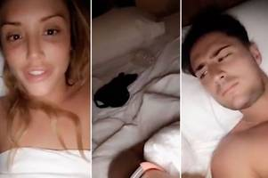 Charlotte Crosby wets the bed AGAIN as she lies topless with Stephen Bear