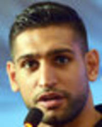 Amir Khan believes a fight with Manny Pacquiao can still happen