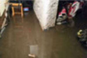 Flood water a foot deep as homes pumped out by fire crews in...