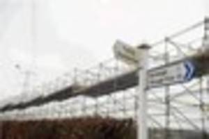 scaffolding towers erected under devon power cables