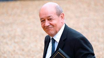 french election: defence minister le drian defects to macron