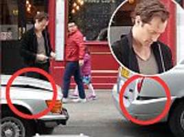 jude law crashes his convertible into cab in london