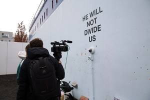 he will not divide us art project moves overseas