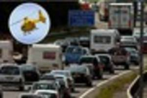 Woman taken to hospital after falling from bridge on M5 between...