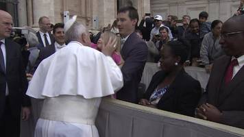 young girl removes pope francis's skullcap