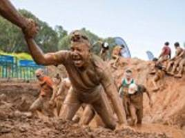 thrill seekers battle through miles of sludge for mud day
