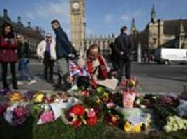 Hundreds of floral tributes are laid in Parliament Square