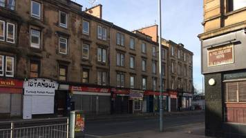 man arrested after taxi office assault in glasgow