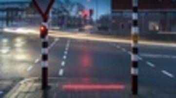 a dutch town put traffic lights on the sidewalk because of texting pedestrians. should new york?