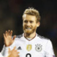 germany crush azeris to go seven points clear