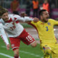 romania held to goalless draw by denmark