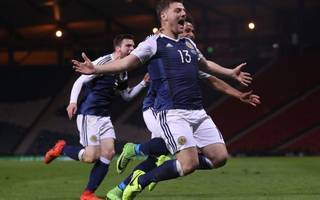 strachan hits back at boo-boys as scotland seal late win