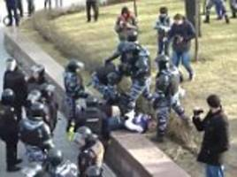 moscow police kick and punch protesters in violent footage