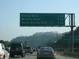 the auto industry is going to hit a wall with california's clean-air rules (f, gm, fcau)