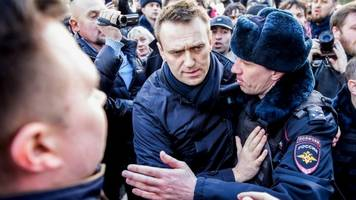 russia protests: eu demands release of detainees