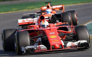 ferrari shares driven to new high after vettel's f1 triumph