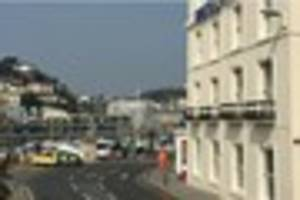 police called to torquay harbourside as man threatens to jump...