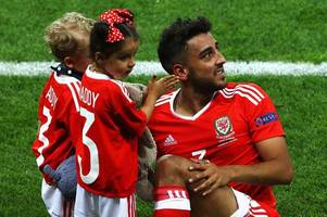 Scumbag, your daughter will be so proud of you Trolls target Neil Taylor's family Facebook photo
