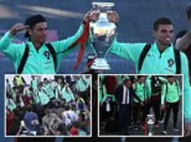 cristiano ronaldo and portugal show off euro 2016 trophy