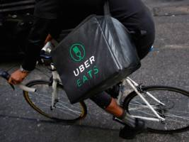 uber looks to play catch-up with deliveroo in the uk as it aggressively expands its food delivery business