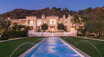 billionaire slashes asking price for beverly hills mega- mansion by a third, or $66 million
