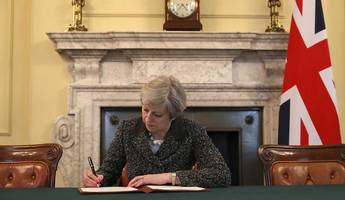 theresa may signs brexit letter: what happens once article 50 is triggered?