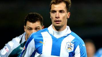 jon gorenc stankovic: huddersfield town defender out for up to 10 months