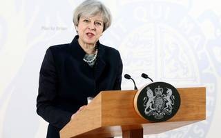 may begins historic brexit process with call for unity