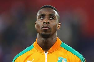 former bristol city star jonathan kodjia caught up in trouble as the ivory coast's clash against senegal is abandoned