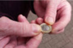 WATCH New £1 coin arrives at banks in Burton and we hit the...