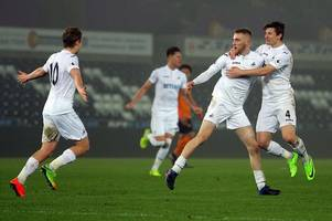 swansea city star oliver mcburnie reveals the truth about why he wears his socks around his ankles