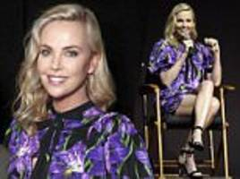 charlize theron sports flower print dress at cinemacon