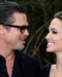 Divorce on hold? Brad Pitt and Angelina Jolie 'reunite for family holiday'