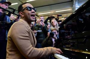 watch john legend surprise commuters with impromptu piano performance at london's st pancras station as he announces scottish tour date
