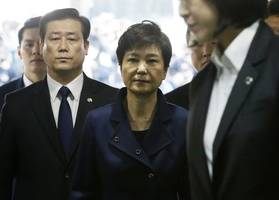 arrest warrant issued for ousted south korean president