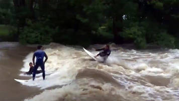 australians surf the flooded streets from tropical cyclone debbie; video