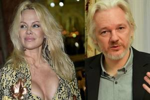 pamela anderson admits dating wanted wikileaks chief julian assange is a 'bit difficult' as romance rumours swirl